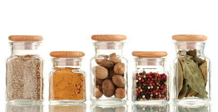 powder spices in glass jars  isolated on white photo