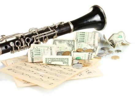 musical instrument with money isolated on white photo