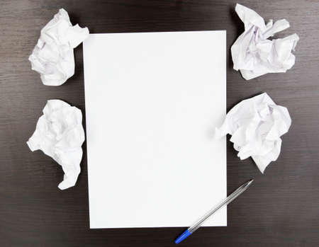 empty paper, crumpled paper and pen on wooden table Stock Photo - 14921625