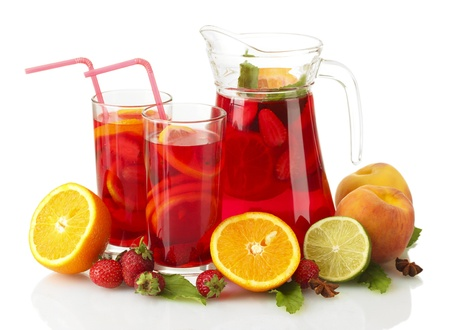 sangria in jar and glasses with fruits, isolated on white photo