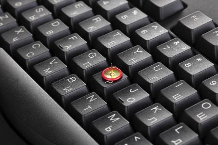 Painful typing, pin on keyboard close-up photo