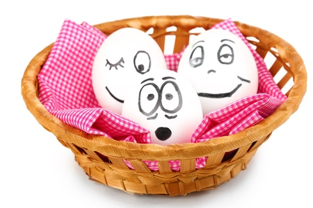 White eggs with funny faces in basket isolated on white Stock Photo - 14954690