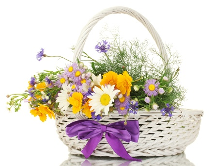 mixed flower bouquet: beautiful bouquet of bright  wildflowers in basket, isolated on white