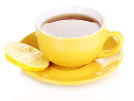 Yellow cup and saucer isolated on white photo