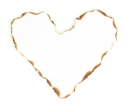 Burnt heart-shaped paper isolated on white photo