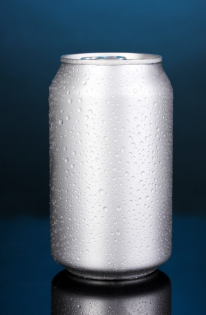 aluminum can on blue background photo