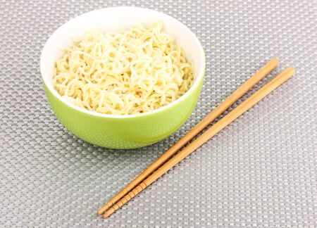asian noodles in bowl on grey mat photo