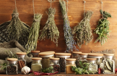 dried spice: dried herbs, spices and and pepper, on wooden background Stock Photo
