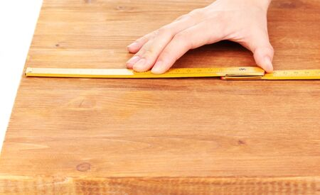 measuring wooden board close-up photo