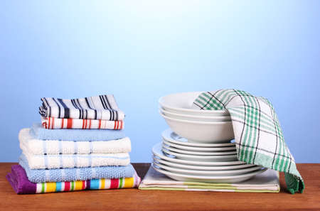 dishcloth: kitchen towels with dishes on blue background close-up