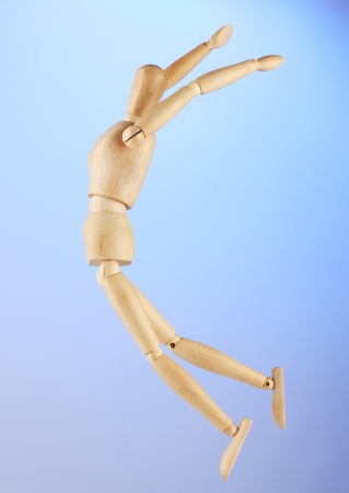 wooden mannequin, on blue background Stock Photo - 14953585