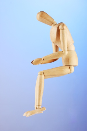 wooden mannequin, on blue background Stock Photo - 14954846