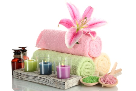 towels with lily, aroma oil,  candles and sea salt isolated on white Stock Photo - 14954233