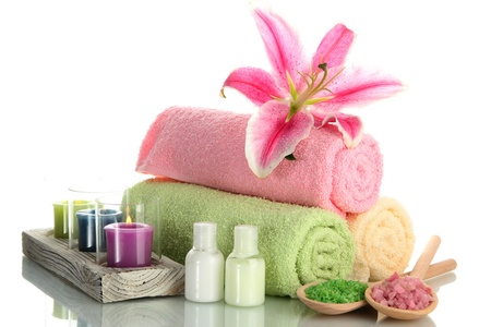 color therapy: towels with lily, aroma oil,  candles and sea salt isolated on white