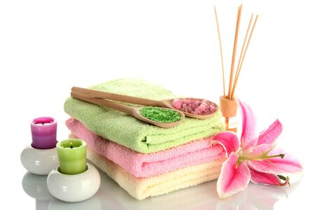 towels with lily, aroma oil,  candles and sea salt isolated on white Stock Photo - 14936323