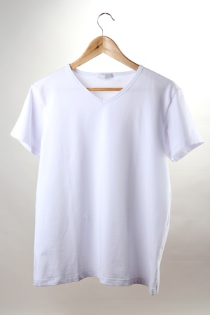 shirts on hangers: white t-shirt on hanger isolated on white