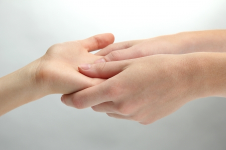 Hand massage, on grey background photo