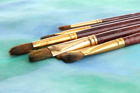 brushes on bright abstract gouache painted background Stock Photo - 14955371
