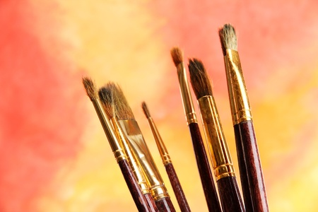 brushes on bright abstract gouache painted background Stock Photo - 14947212