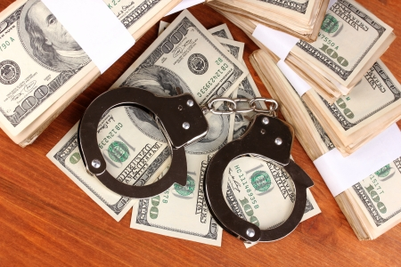 idea of punishment for financial fraud, on wooden background Stock Photo - 14956042