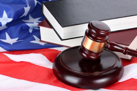 government: judge gavel and books on american flag background