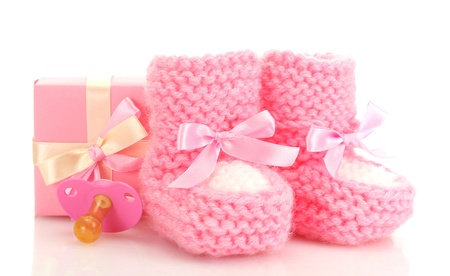 pink baby boots, pacifier and gift isolated on white photo