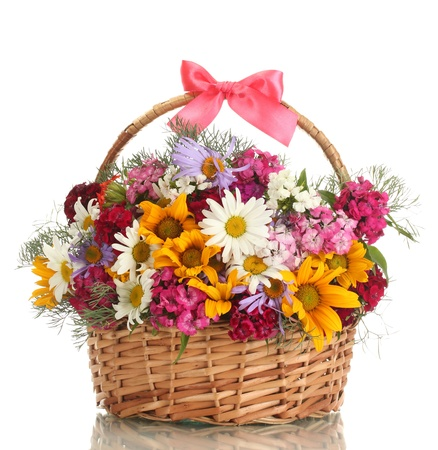 wildflowers: beautiful bouquet of bright  wildflowers in basket, isolated on white