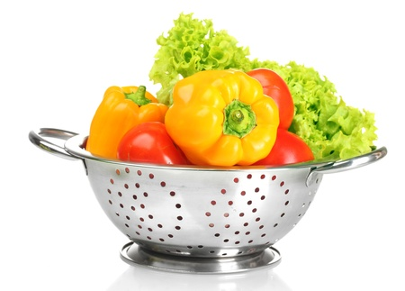 fresh vegetables in silver colander isolated on white Stock Photo - 15008619