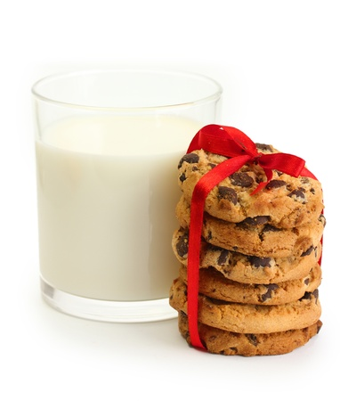 glass of milk and chocolate chips cookies with red ribbon isolated on white Stock Photo - 15009841