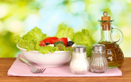 tasty greek salad on bright green background photo