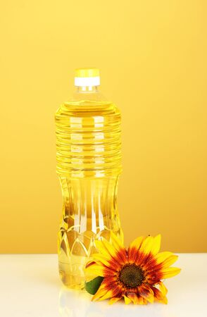 sunflower oil in a plastic bottle on yellow background photo