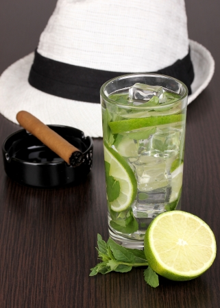 mohito: Mojito and a hat on a wooden background
