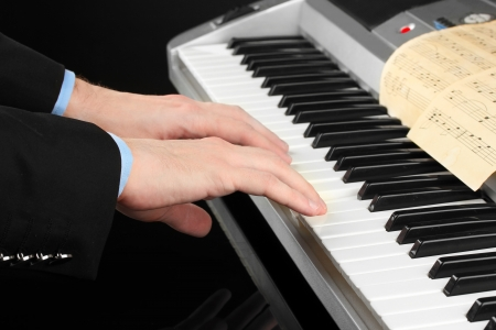 man hands playing piano photo