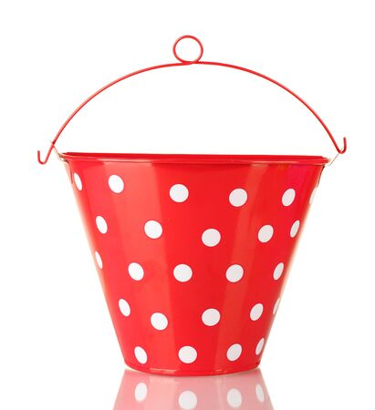 Red bucket with white polka-dot isolated on white photo
