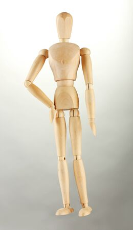 wooden mannequin, on grey background Stock Photo - 15008228