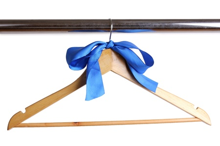 Beautiful blue bow hanging on wooden hanger isolated on white photo