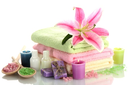 towels with lily, aroma oil,  candles, soap and sea salt isolated on white photo