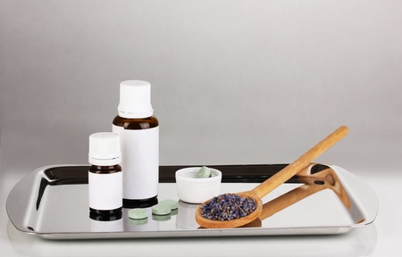 Alternative therapies on the silver tray on gray background close-up Stock Photo - 15015128