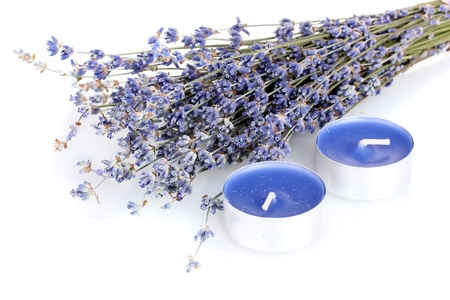 lavendin: Lavender flowers and candles isolated on white
