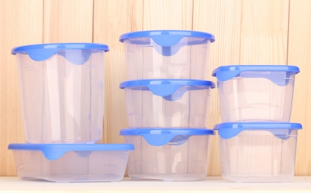 Plastic containers for food on wooden background Stock Photo - 15065735
