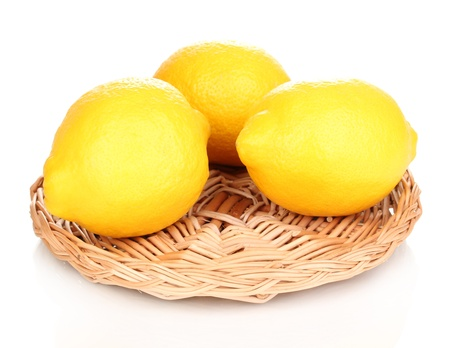 Lemons in a board isolated on white