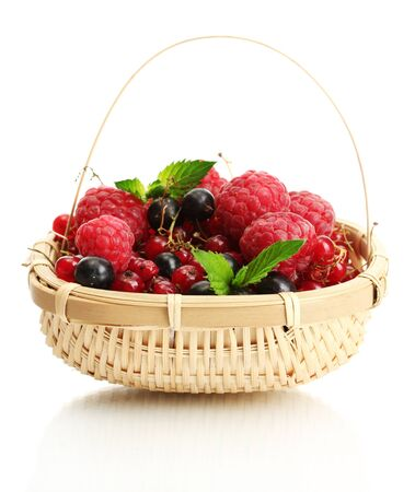 ripe berries with mint in basket isolated on white  photo
