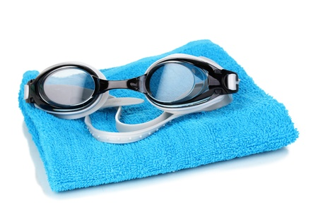 towel beach: Swim goggles on towel isolated on white