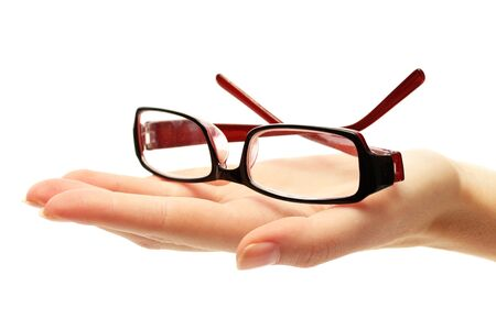 doctor of optometry: glasses on female hand, isolated on white Stock Photo