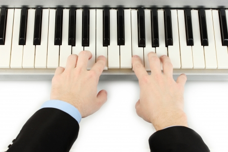 hands of man playing piano photo