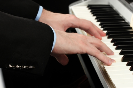 man hands playing piano Stock Photo - 15048317