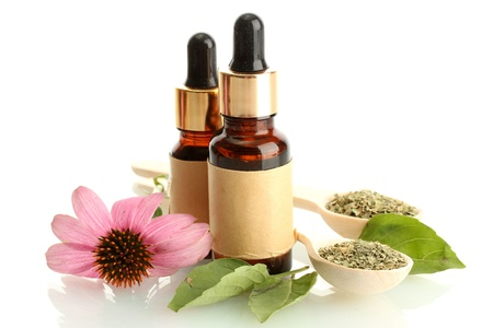 homeopathy: bottles with essence oil and purple echinacea , isolated on white