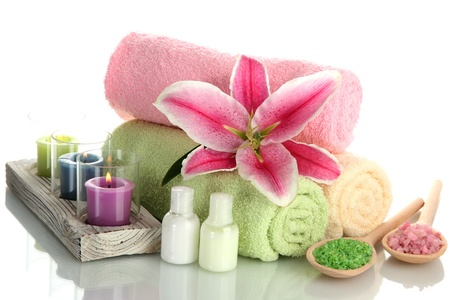 towels with lily, aroma oil,  candles and sea salt isolated on white Stock Photo - 15048477