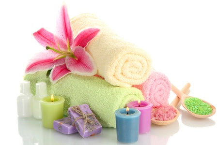 towels with lily, aroma oil,  candles, soap and sea salt isolated on white Stock Photo - 15048291