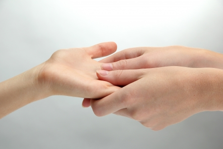 Hand massage, on grey background photo